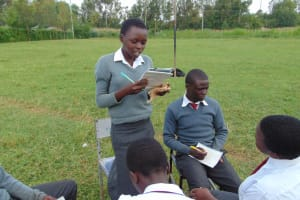 The Water Project: Ebulonga Mixed Secondary School -  A Pupil Reads Her Groups Answers
