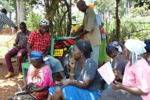 The Water Project: Masuveni Community, Masuveni Spring -  Participants Listen And Take Notes