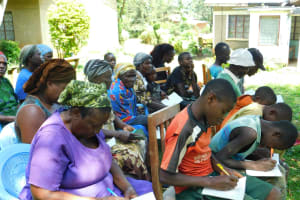 The Water Project: Bumira Community, Madegwa Spring -  Training Participants Taking Notes