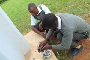 The Water Project: Ebulonga Mixed Secondary School -  Pupils Crush Charcoal As Toothpaste Replacement For Toothbrushing Practical
