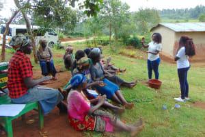 The Water Project: Masuveni Community, Masuveni Spring -  Handwashing Session Led By Trainer Laura Alulu