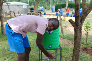 The Water Project: Banja Primary School -  Student Clintone Uses A Handwashing Station