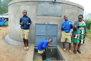 The Water Project: Shichinji Primary School -  Students And Teacher With Rain Tank