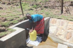 The Water Project: Sambaka Community, Sambaka Spring -  All Smiles Fetching Water