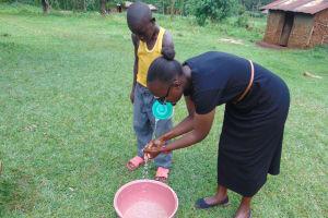 The Water Project: Munenga Community, Francis Were Spring -  Joan Demonstrates Handwashing