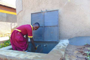 The Water Project: Nanganda Primary School -  Getting A Fresh Drink