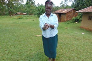 The Water Project: Munenga Community, Francis Were Spring -  A Community Member Demonstrates Handwashing