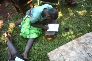 The Water Project: Emulembo Community, Gideon Spring -  High School Student Takes Notes During Training