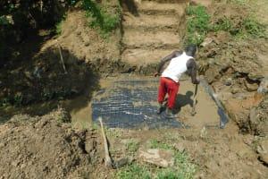 The Water Project: Sambaka Community, Sambaka Spring -  Adding Concrete To Foundation