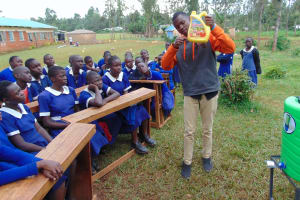 The Water Project: Demesi Primary School -  Leaky Tin For Handwashing Demonstration