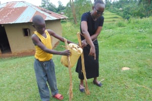 The Water Project: Munenga Community, Francis Were Spring -  Joan Shows How To Construct A Tippy Tap