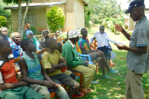 The Water Project: Bumira Community, Madegwa Spring -  Community Member Shares A Response During Training
