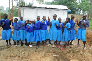 The Water Project: Shichinji Primary School -  Girls Pose With Their New Latrines
