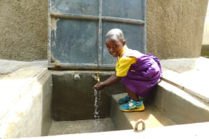 The Water Project: Kapkures Primary School -  Water Flows From The Completed Rain Tank