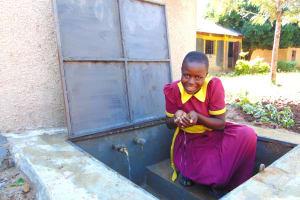 The Water Project: Nanganda Primary School -  Fresh Water In Hand