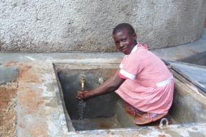 The Water Project: Kakamega Muslim Primary School -  Enjoying The Fresh Water