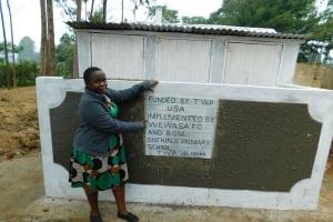 The Water Project: Shichinji Primary School -  Sanitation Teacher Madam Ellah Poses With The Girls Latrines