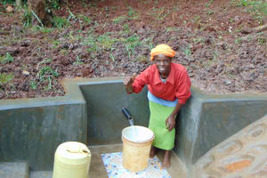 The Water Project: Masuveni Community, Masuveni Spring -  Thumbs Up For Flowing Water