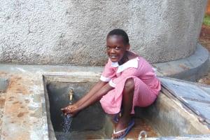 The Water Project: Kakamega Muslim Primary School -  Enjoying Rain Tank Water