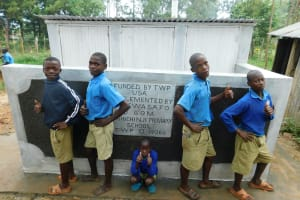 The Water Project: Shichinji Primary School -  Boys Pose With Their New Latrines