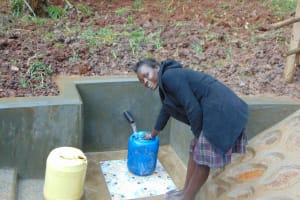 The Water Project: Masuveni Community, Masuveni Spring -  Smiles Fetching Water