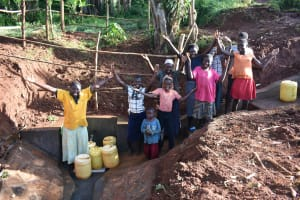 The Water Project: Emulembo Community, Gideon Spring -  Community Members Celebrate Finished Spring