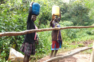 The Water Project: Masuveni Community, Masuveni Spring -  Happy To Be Heading Home With Clean Water
