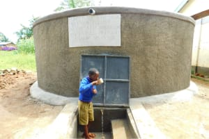 The Water Project: Kapkures Primary School -  Enjoying A Fresh Drink