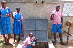 The Water Project: Banja Primary School -  Students Pose With The Rain Tank