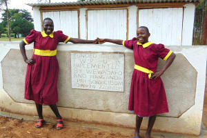 The Water Project: Nanganda Primary School -  Girls Pose With Their New Latrines