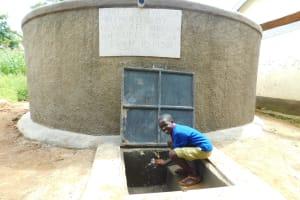 The Water Project: Kapkures Primary School -  Enjoying Rain Tank Water