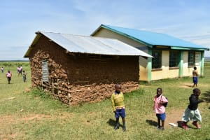 The Water Project: Eshimuli Primary School -  Children Play Next To A Mud Classroom Now Used As A Kitchen