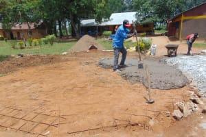 The Water Project: Nanganda Primary School -  Adding Concrete To Foundation