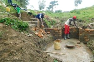 The Water Project: Sambaka Community, Sambaka Spring -  Headwall Construction