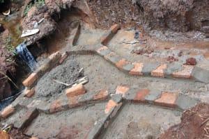 The Water Project: Masuveni Community, Masuveni Spring -  First Bricks Set