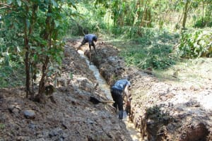 The Water Project: Bumira Community, Madegwa Spring -  Opening Up Drainage Channel
