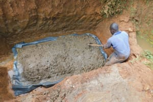 The Water Project: Emulembo Community, Gideon Spring -  Pouring Concrete Spring Foundation