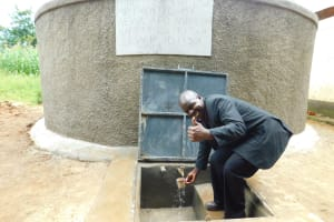 The Water Project: Kapkures Primary School -  School Administrator Celebrates The Tank