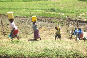 The Water Project: Sambaka Community, Sambaka Spring -  Heading Home With Clean Spring Water