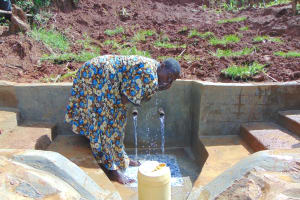The Water Project: Munenga Community, Francis Were Spring -  Enjoying A Fresh Drink