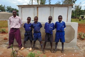 The Water Project: Demesi Primary School -  Boys Pose With Their New Latrines