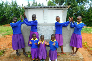 The Water Project: Kapkures Primary School -  Girls Pose With Their New Latrines