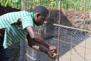The Water Project: Banja Primary School -  Adjusting The Wire Wall Forms