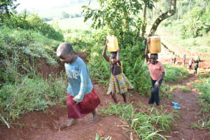 The Water Project: Emulembo Community, Gideon Spring -  Children Walking Home With Water
