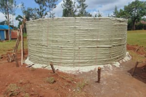 The Water Project: Demesi Primary School -  Rain Tank Walls With Plastic Covering