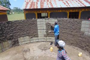 The Water Project: Nanganda Primary School -  Cementing Inside The Rain Tank