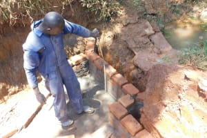 The Water Project: Emulembo Community, Gideon Spring -  Artisan Measures Spring Headwall