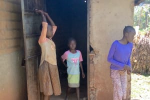 The Water Project: Shikhombero Community, Atondola Spring -  Girls Stand In Front Of A Kitchen
