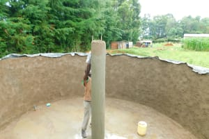 The Water Project: Kapkures Primary School -  Plastering The Central Support Column