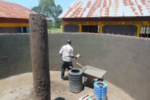The Water Project: Nanganda Primary School -  Plastering Inside Tank